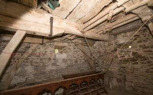 The Bell Ringing Chamber inside Nevern Church, Wooden beams with stone walls. St Brynach, Nevern, Pembrokeshire