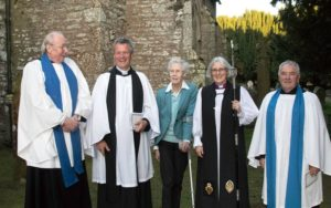 Bishop Jo (second from right) standing with the other members of Nevern Church outside the church. St Brynach, Nevern, Pembrokeshire