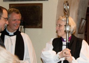 Bishop Jo having a friendly conversation with 2 reverends at Nevern Church, St brynach, Nevern, Pembrokeshire